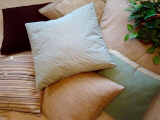 fabric covered Pillows on couch