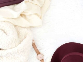 purse scarf hat gloves and watch on white background