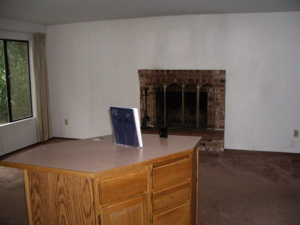 Outdated living room fireplace