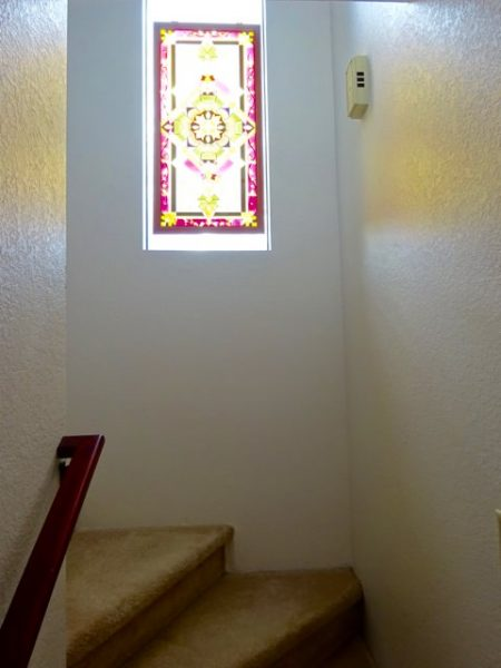 Stairwell window with stained glass