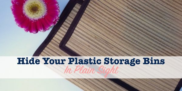 straw mat used to hide plastic storage bins in plain sight