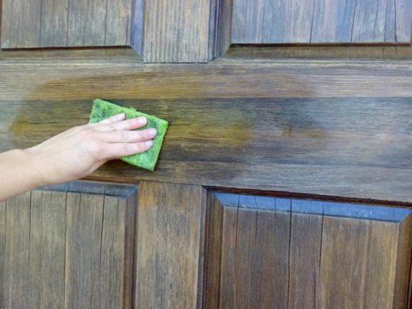 Prepare to stain a wood door.