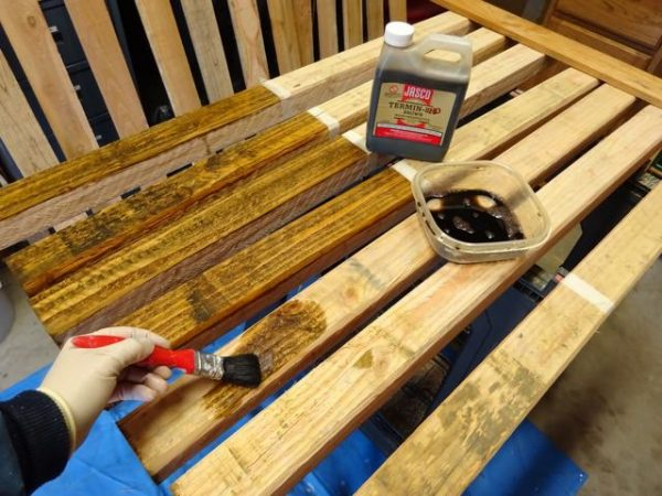 Applying weatherproofing product to wooden fence posts