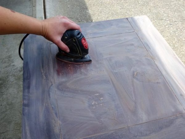 Sand and refinish a damaged wood table