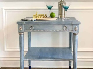 upcycled thrift store end table with cocktail glasses