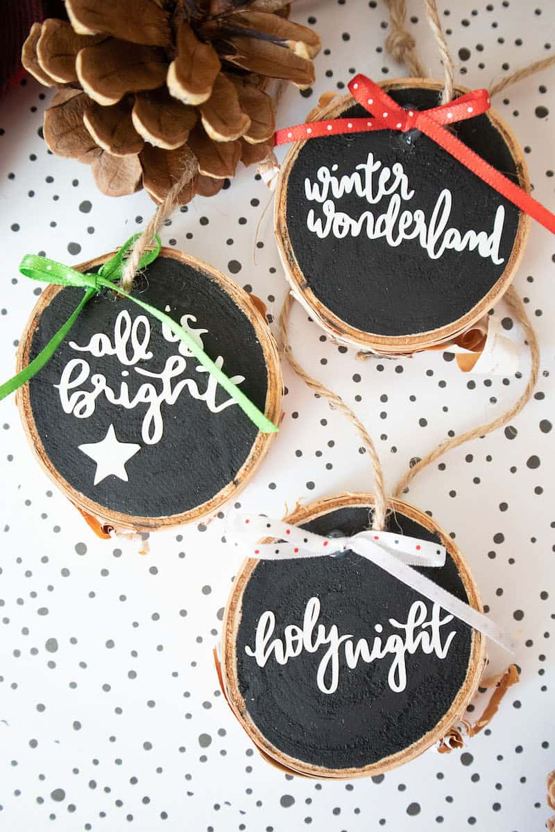 Lettered wood slice ornaments with twine and fabric bows