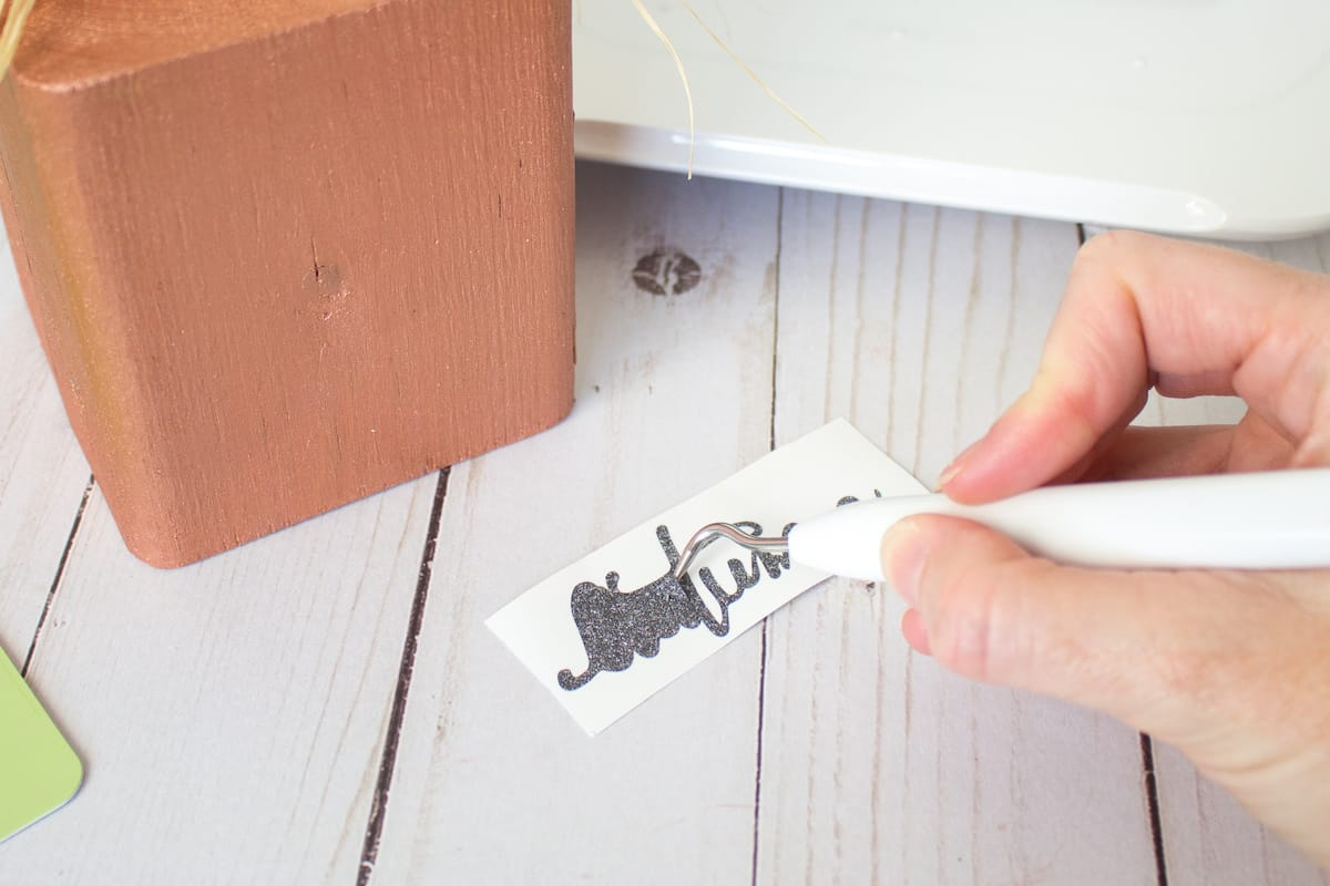using cricut tool to remove excess vinyl from letters