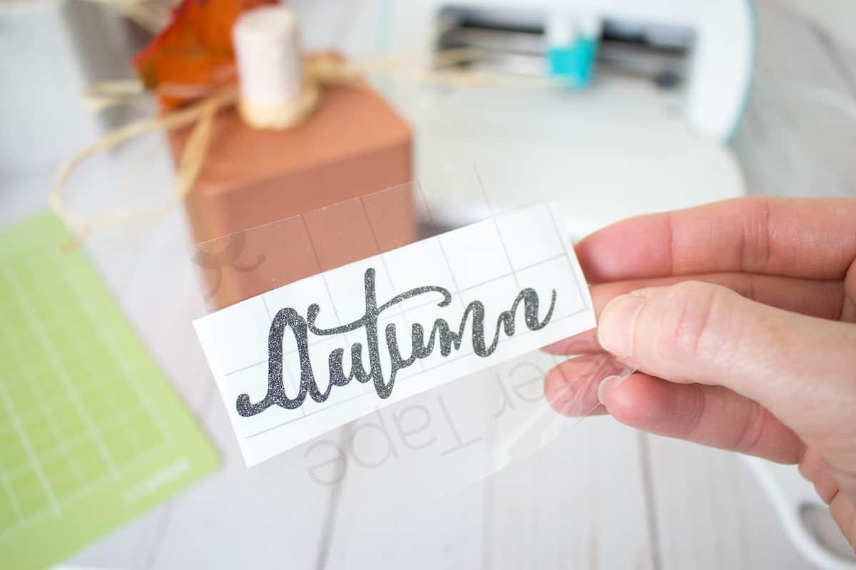 cutting out cricut vinyl letters for wood pumpkin blocks