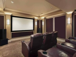 Theater room in luxury home with lounge chairs