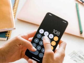 woman using calculator on mobile phone