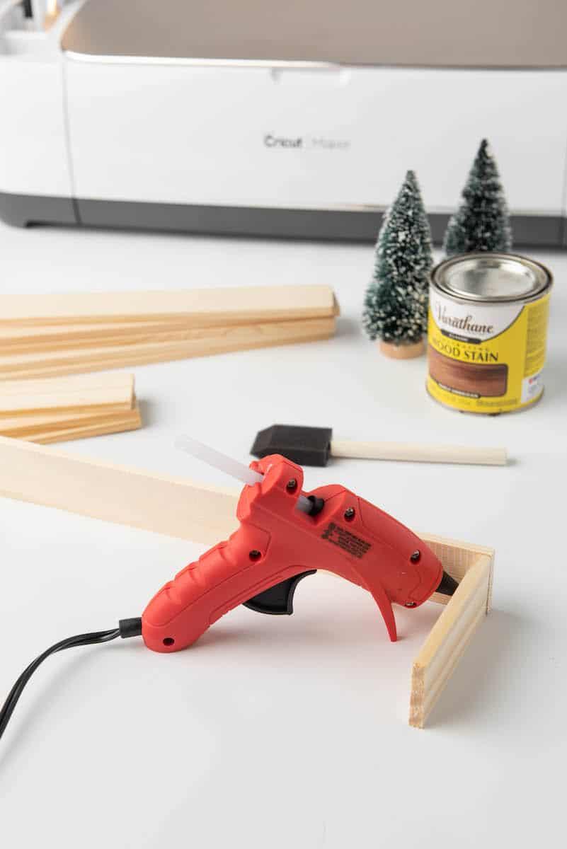 hot glue gun on wood craft