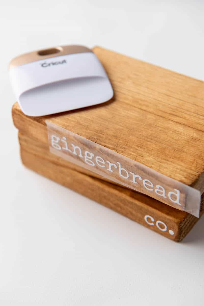 wooden books that say gingerbread co on the spine