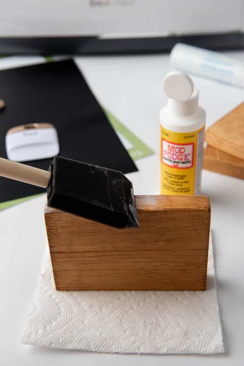 painting wooden book with Mod Podge