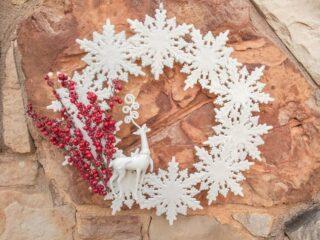 winter wonderland wreath hanging on a rock wall