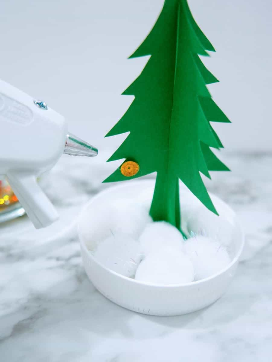 Hot Glue Gun with Sequin on Paper Christmas Tree