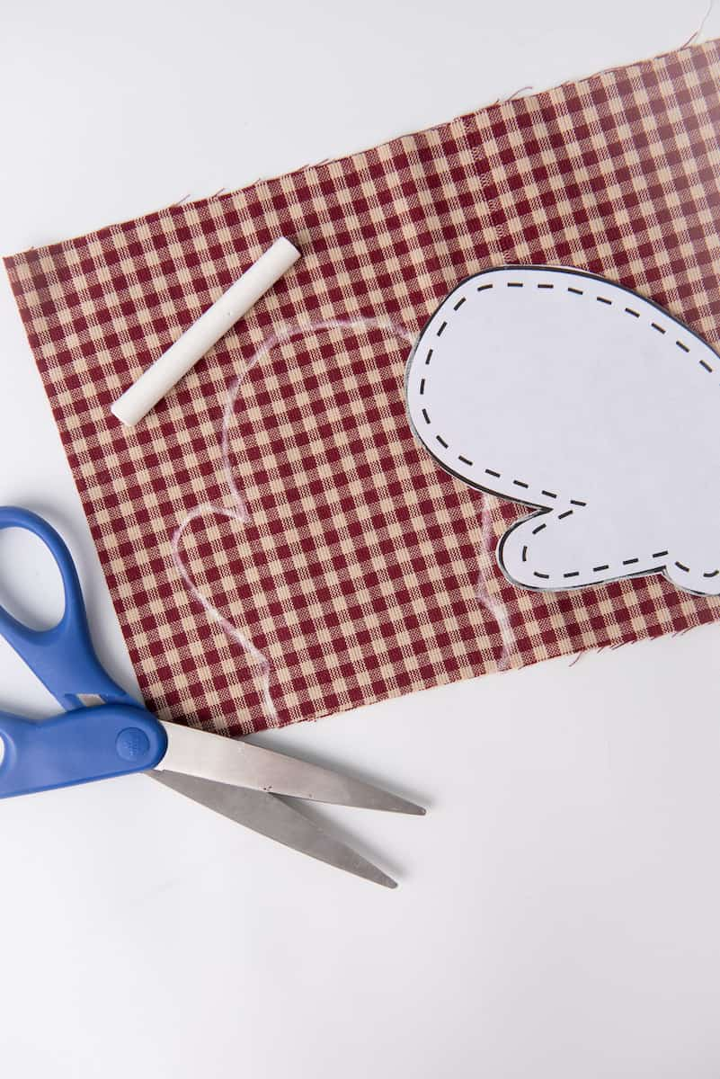 Cutting Mitten Out of Checkered Fabric