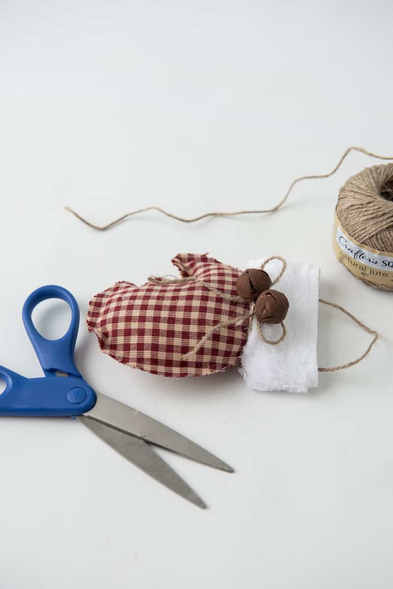 Tying Rustic Bells on to Ornament with Twine