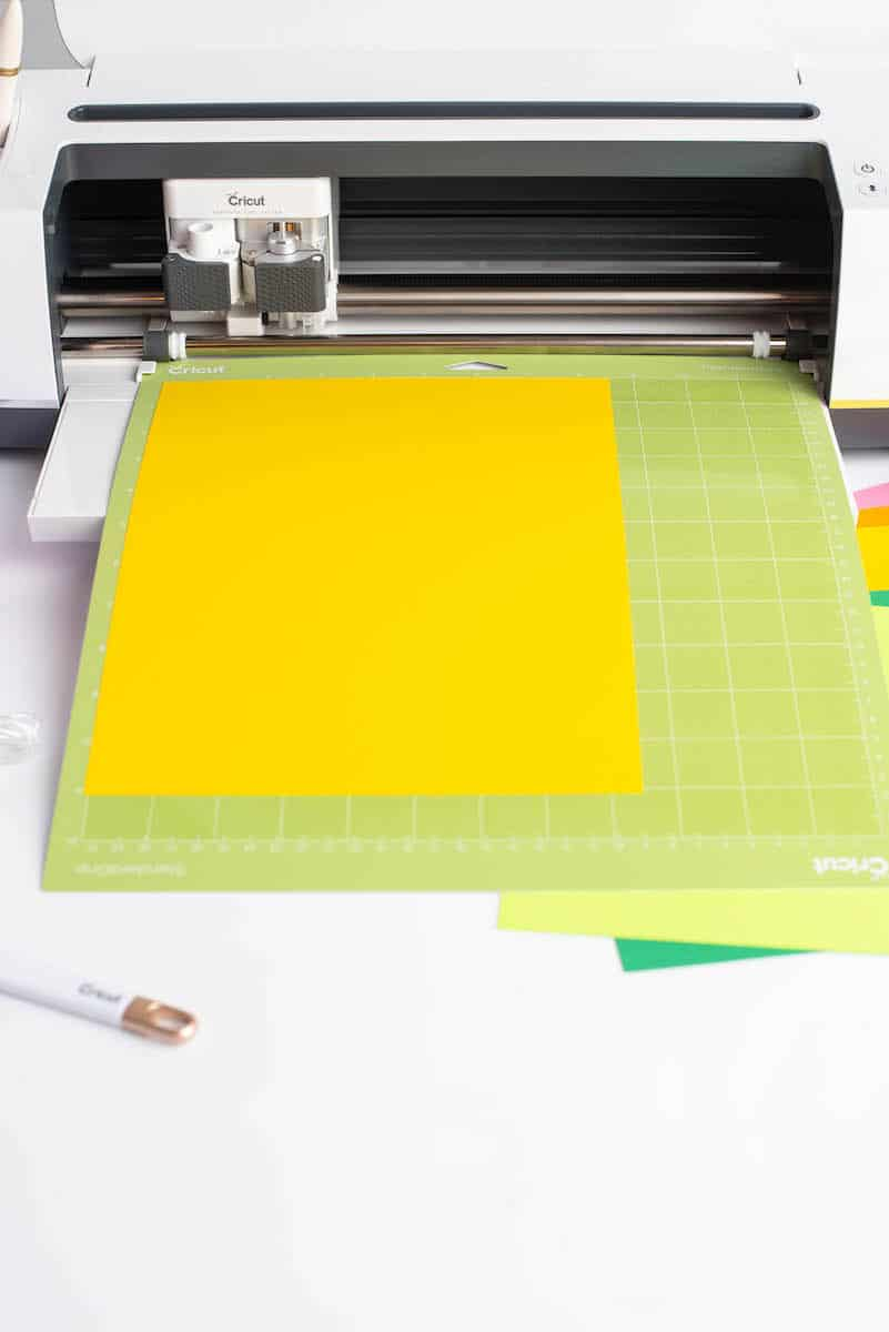 yellow paper on mat in Cricut Maker machine