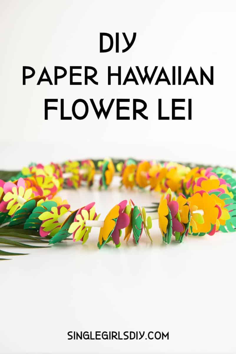 paper flower lei on against white background