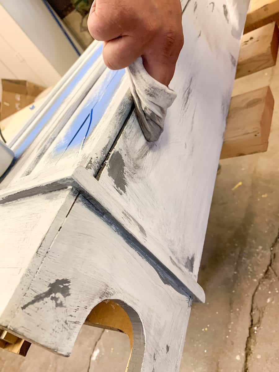 Distressing furniture with gray paint