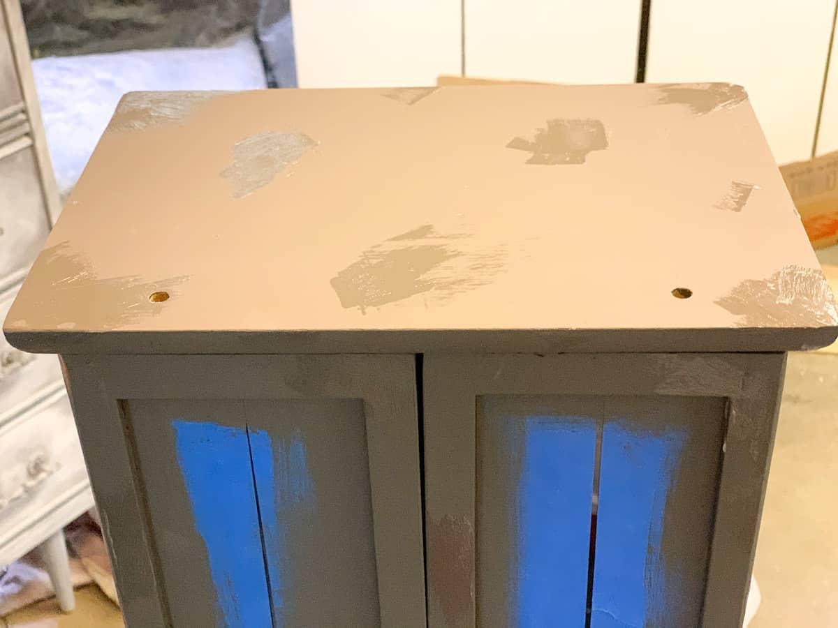 Vaseline on furniture for distressed paint DIY