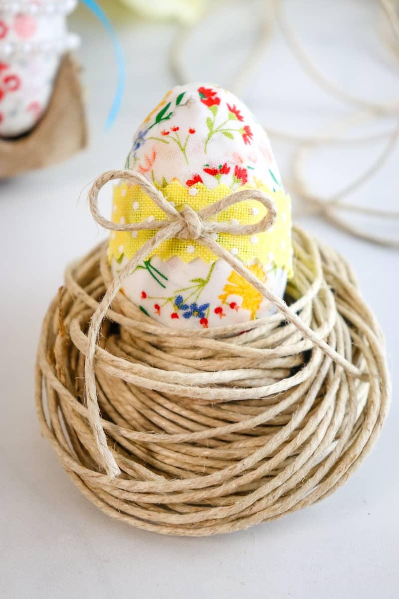 Decoupage Easter Eggs sitting in twine nest