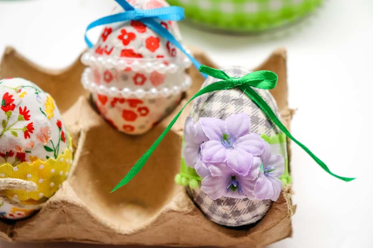 Decoupage Easter Eggs in brown cardboard egg holder