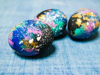 Galaxy Easter eggs on light blue background