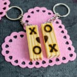 tumbling towers game Block Keychain with pink heart background