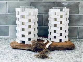 Jenga blocks DIY candle holder on grey background