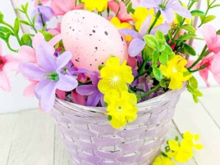 Easter eggs and flowers in a purple basket