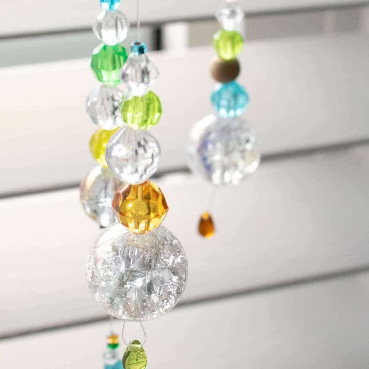 DIY Suncatcher with Beads shinning in sunlight