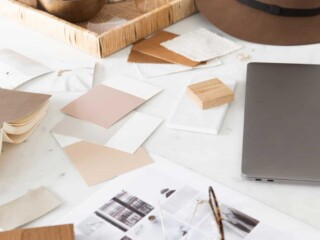 messy desk with home design projects