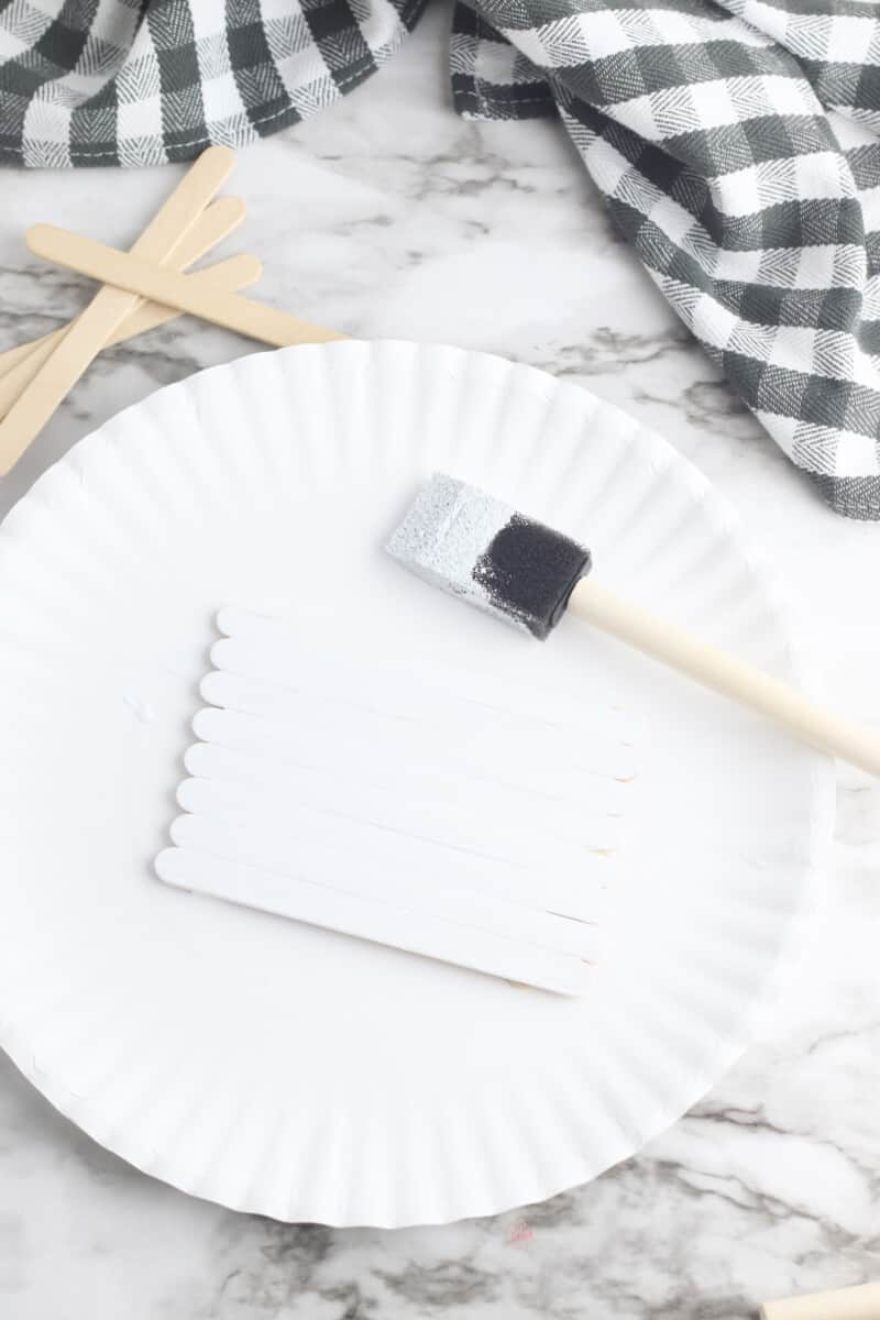 painting popsicle stick pallet white