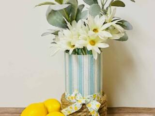 decoupaged paper napkin glass vase with lemons on wood table