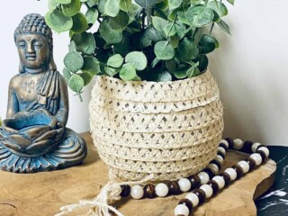 boho vase filled with greenery