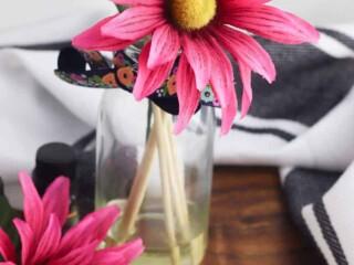 faux flower in bottle of essential oils