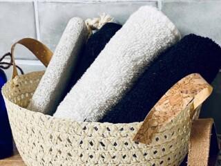 straw hat wicker basket stuffed with washcloths