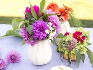 diy pumpkin vases with colorful flowers inside