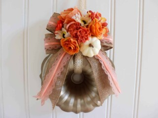 pumpkin wreath with flowers made out of a bundt pan
