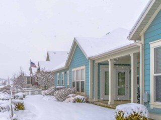 row of houses covered in snow