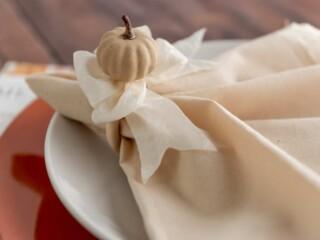 handmade fall napkin holder with a pumpkin and ribbon