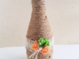decorated glass bottle with twine
