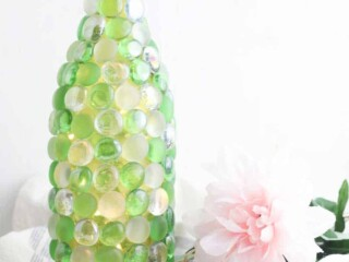 beaded glass bottle used as a vase