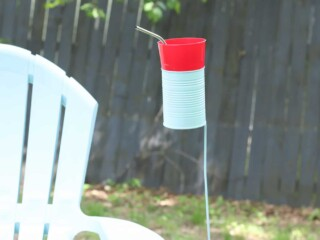 tin can drink holder by outdoor chair