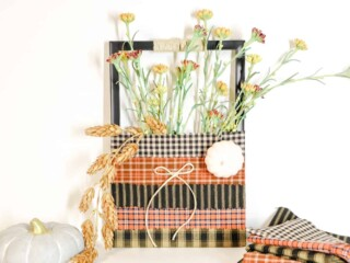 old picture frame turned into a decorative flower vase