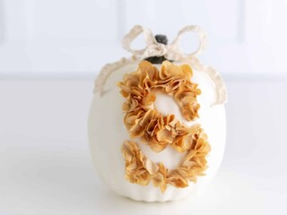 farmhouse white pumpkin with monogram letter made out of flower petals