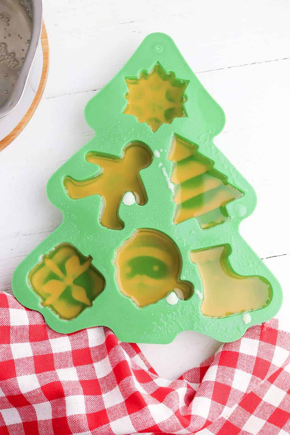 hot melted beeswax in christmas tree mold