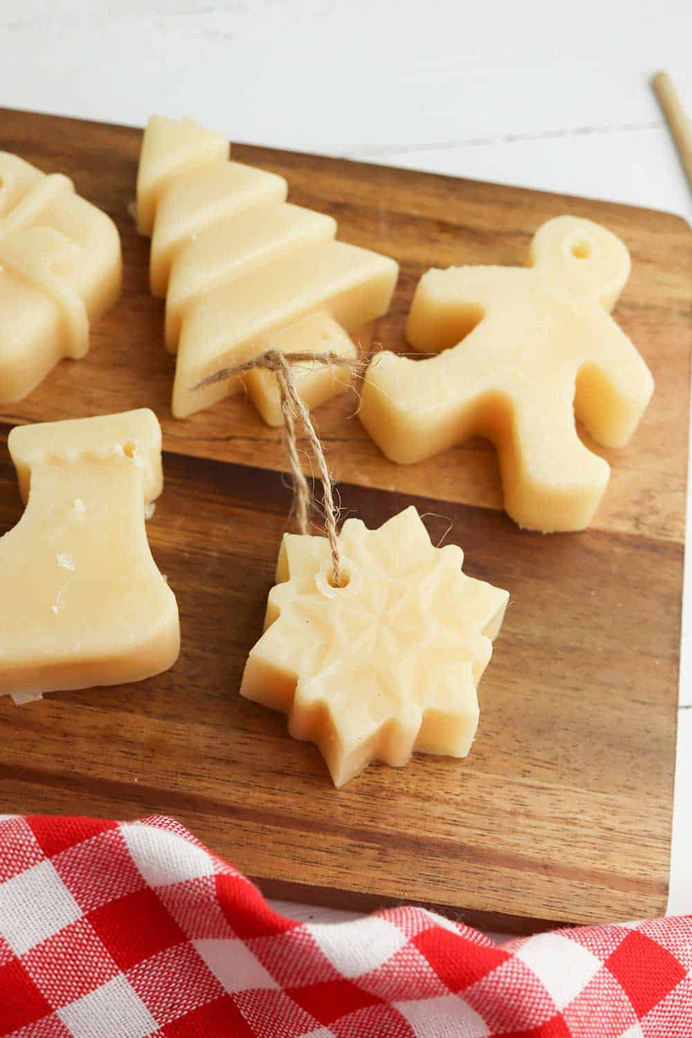 variety of beeswax christmas ornaments on wooden tray